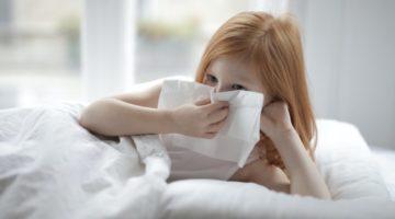 Girl in Bed Not Feeling Well